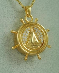 Gold boat wheel pendant urn