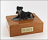 Schnauzer, Black-Silver Laying Dog Figurine Cremation Urn