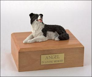 Border Collie White-Black Laying Dog Figurine Cremation Urn